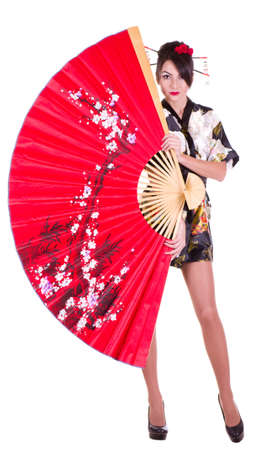 Beautiful young woman in Asian costume with red Asian fan photo