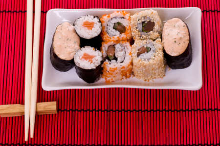 Set of sushi rolls on the white plate photo