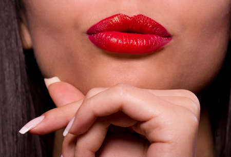 Beautiful red gloss lips with kissing gesture. Stock Photo - 12235166