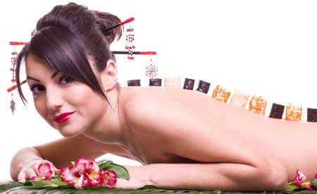 model fish: Young beautiful woman with Japanese sushi rolls, isolated