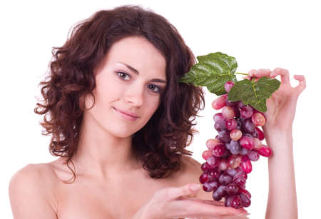 Beautiful young woman with red grape on white background. photo