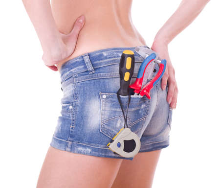 Beautiful female worker with tools in back pocket on shorts photo