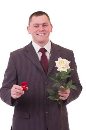 Valentines Man with flowers and gift isolated on white background. Proposal scene photo