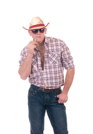 Pretty man with cowboy hat on white background photo