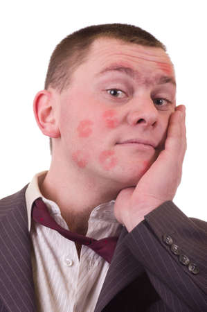 ravaged: Surprised kissed man suit over white background