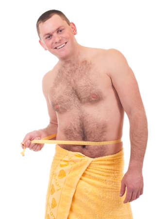 Beautiful athletic man in yellow towel on the white background photo