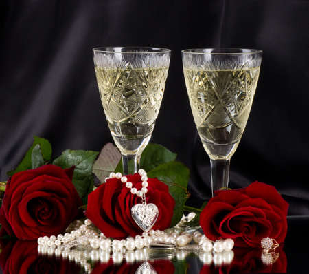 rose wine: White vine glass with red roses on black background