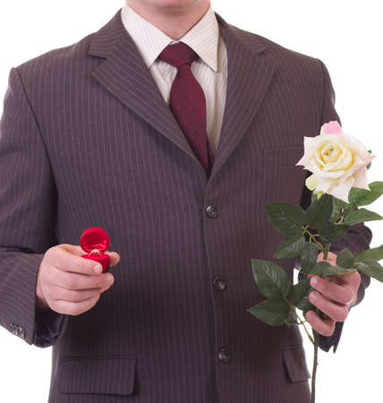 Valentines Man with flowers and gift isolated on white background  Proposal scene photo