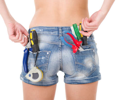 Beautiful female worker with tools in back pocket on shorts Stock Photo - 12362373