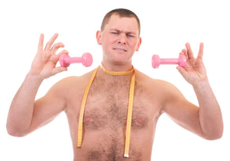 Young man with dumbbells and measure photo