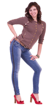 Beautiful young woman in blue jeans on white background photo