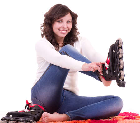 rollerblading: Beautiful young woman in rollers on white background