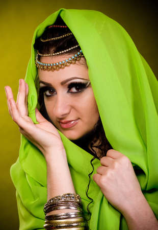 Beautiful young woman in color arabian clothes Stock Photo - 12522052