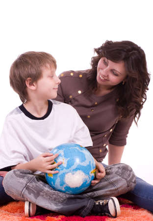 Little schoolboy and mother with globe on a white background photo