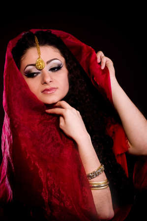 Beautiful young woman in color arabian clothes Stock Photo - 12522038