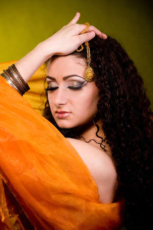 yashmak: Beautiful young woman in color arabian clothes