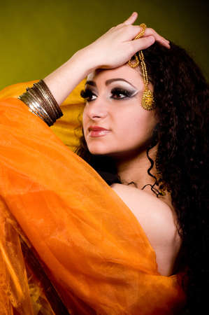 Beautiful young woman in color arabian clothes photo