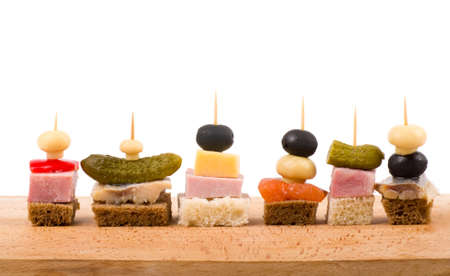 toothpick: Set of tasty canape on a white background