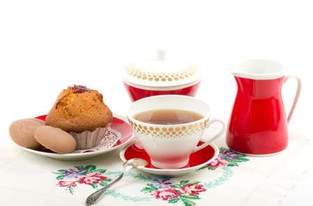 Beautiful tea set with cupcakes on white background Stock Photo - 12560569