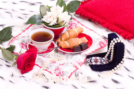 Beautiful romantic breakfast with gifts and rose on a bed photo
