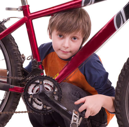 Little beautiful boy with bycicle photo