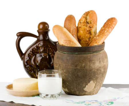 bread basket: Beautiful bread set with milk and cheese on white background Stock Photo