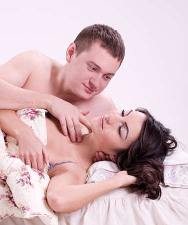 Beautiful pair of lovers in bed photo