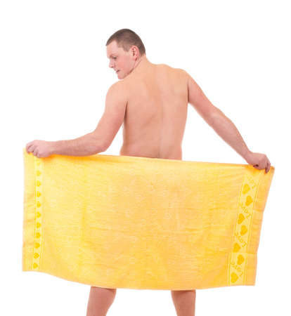 Beautiful athletic man in yellow towel  photo