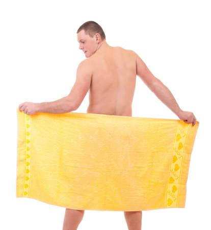 Beautiful athletic man in yellow towel  photo