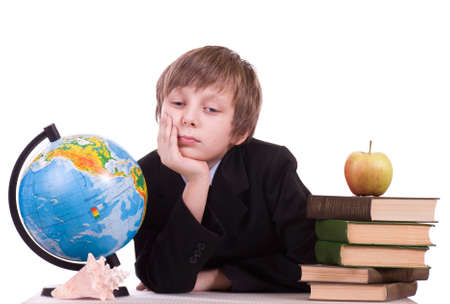 Little schoolboy with globe, books and apple photo