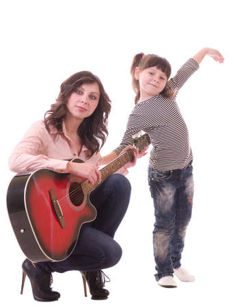mother and her little daughter with guitar photo