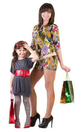 Happy mother and little girl with shopping bags photo