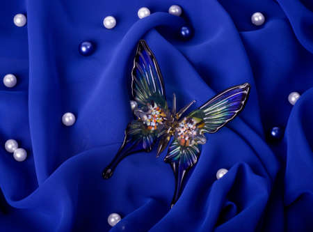 Beautiful butterfly on dark blue fabric photo