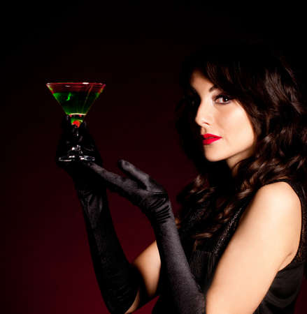 Vintage woman in retro dress with absinthe photo