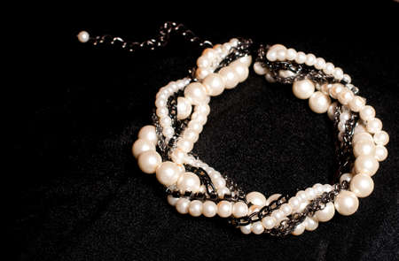 glimmer: Pearl jewelry on black background Stock Photo