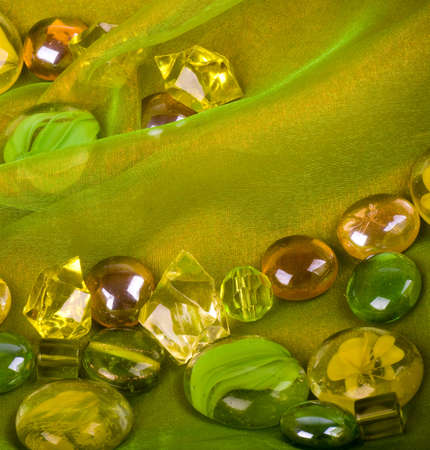 organza: Beautiful bright colorful stones on a green