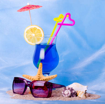 Exotic cocktail with tropical shell and glasses photo