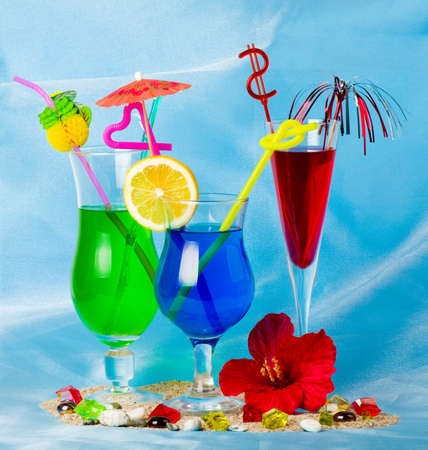 Exotic cocktails with tropical fruit and flowers photo