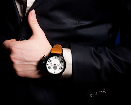Bracelets: Beautiful masculine hand with a clock Stock Photo