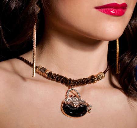 jewlery: Portrait of a beautiful lady with golden jewelry