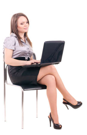palm computer: Young Businesswoman with notebook on chair isolated on a white background