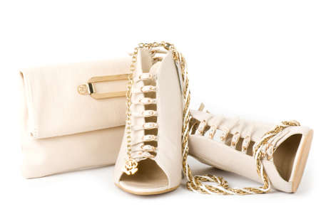 Sexy fashionable shoes, golden jewelry and handbag isolated on white background Stock Photo - 12886405