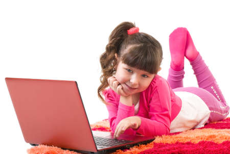 Cute little girl with laptop isolated over white Stock Photo
