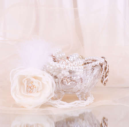 The beautiful bridal rose with wedding beads in crystal vase Stock Photo - 12886407