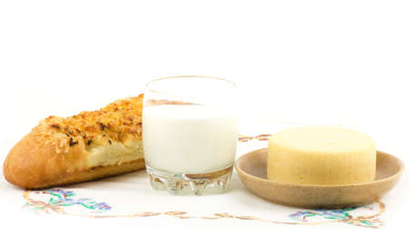 Beautiful bread with milk on white background photo