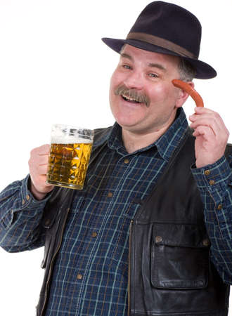 potbelly: Elderly man holding a beer belly and sausage on white background Stock Photo