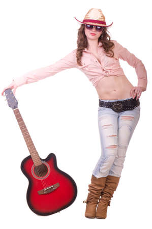 Pretty girl with cowboy hat with guitar on white background photo