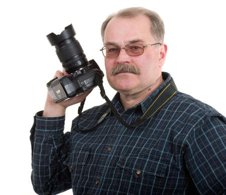 man photographer doing photos by digital camera isolated Stock Photo - 12986683