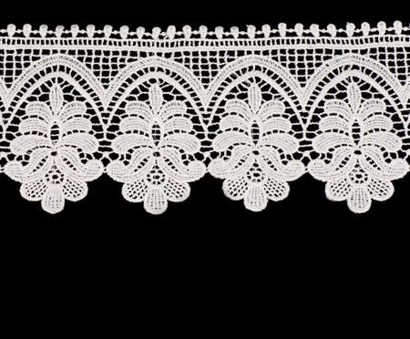 Vintage white lace with flowers on black background photo