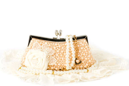 pearl jewelry: Fashionable handbag and pearl jewelry on white background